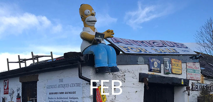 February features a fibreglass Homer Simpson on the roof of an antiques shop