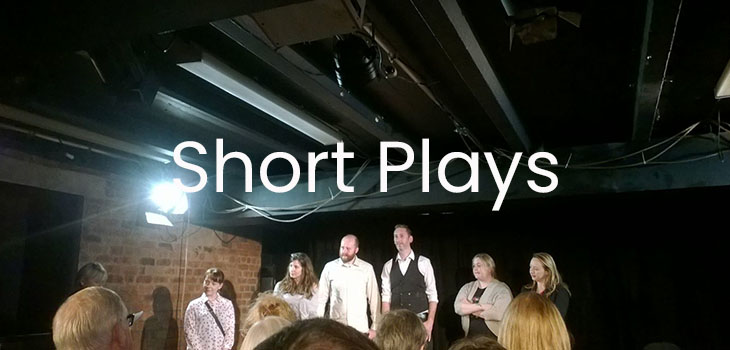 Six writers on stage at Lantern Theatre Liverpool, with the text 'Short Plays' overlaid in white