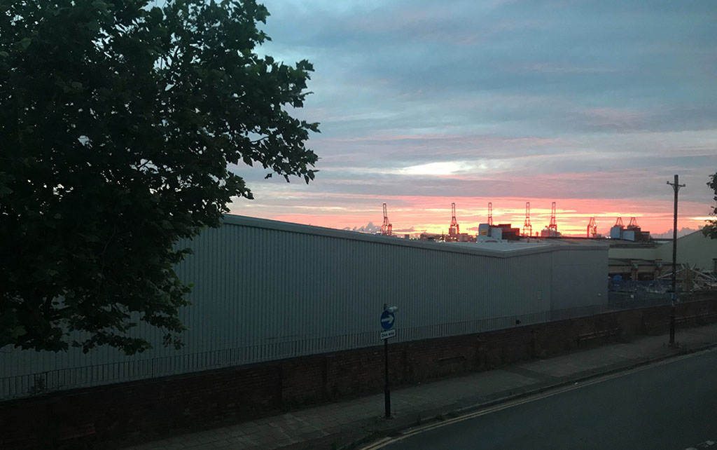 Liverpool's red shipping cranes at sunrise